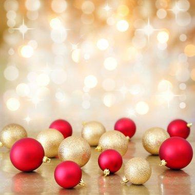 Christmas baubles on defocused lights background