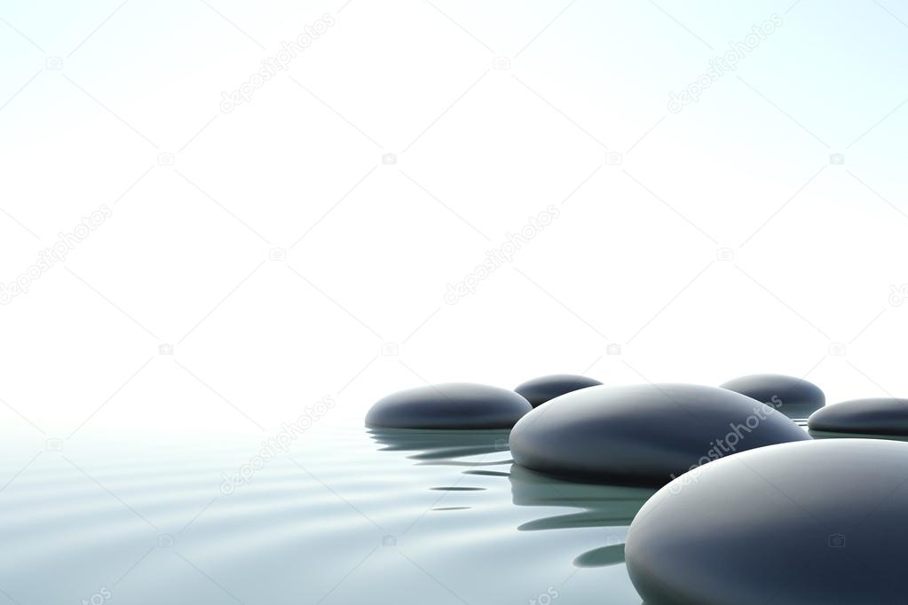Zen stones in water on white background
