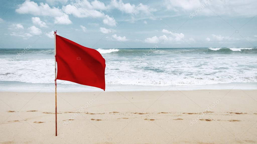 Red flag on the beach on the island of Bali, warning that swimming is prohibited