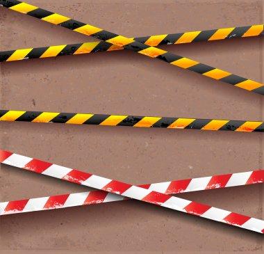 Scratched danger tapes on parcel paper.