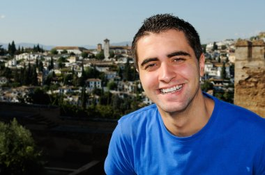 Attractive smiling man portrait in urban background