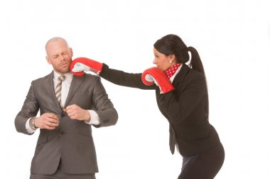 Competitive businesswoman knocks-out competitor