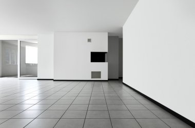 New apartment, empty room with white tiled floor