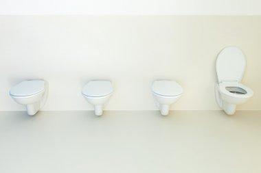 Public bathroom, toilets in a row