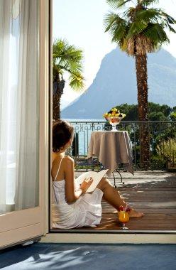 Beautiful woman reading on the terrace
