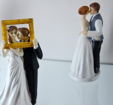 figures of brides and bridegrooms for a wedding cake on top