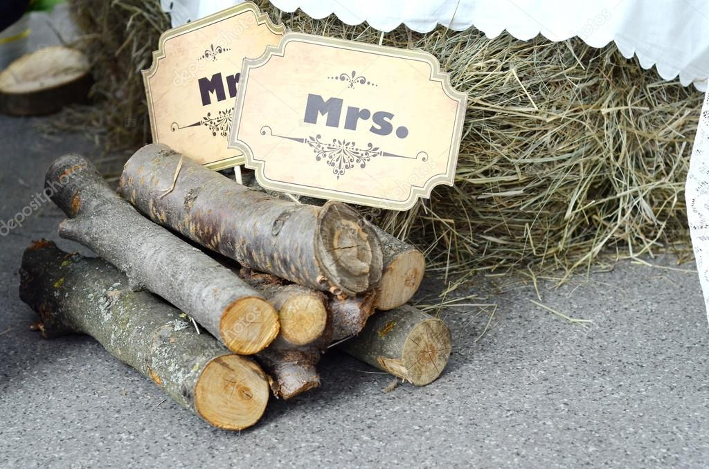 Mister and misses signs on wooden logs, country style wedding