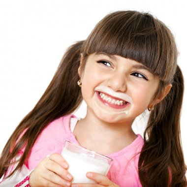 smiling girl with a glass of milk