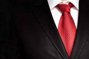 businessman in a black suit with a red tie