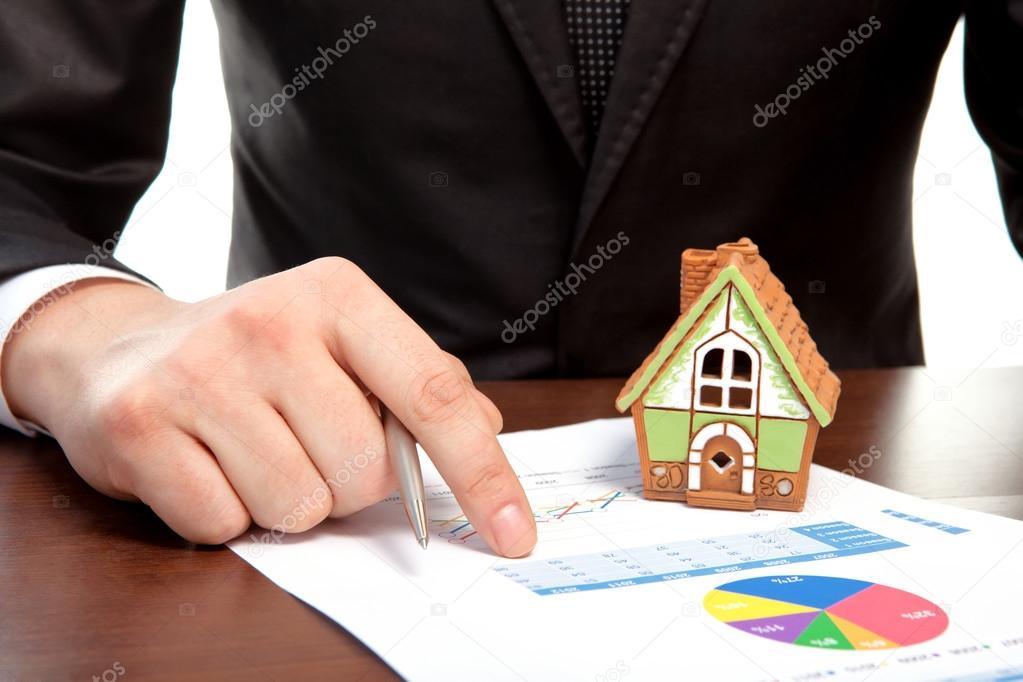 businessman sitting at the table and sign a contract