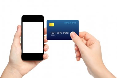 female hands holding phone and credit card on isolated backgroun