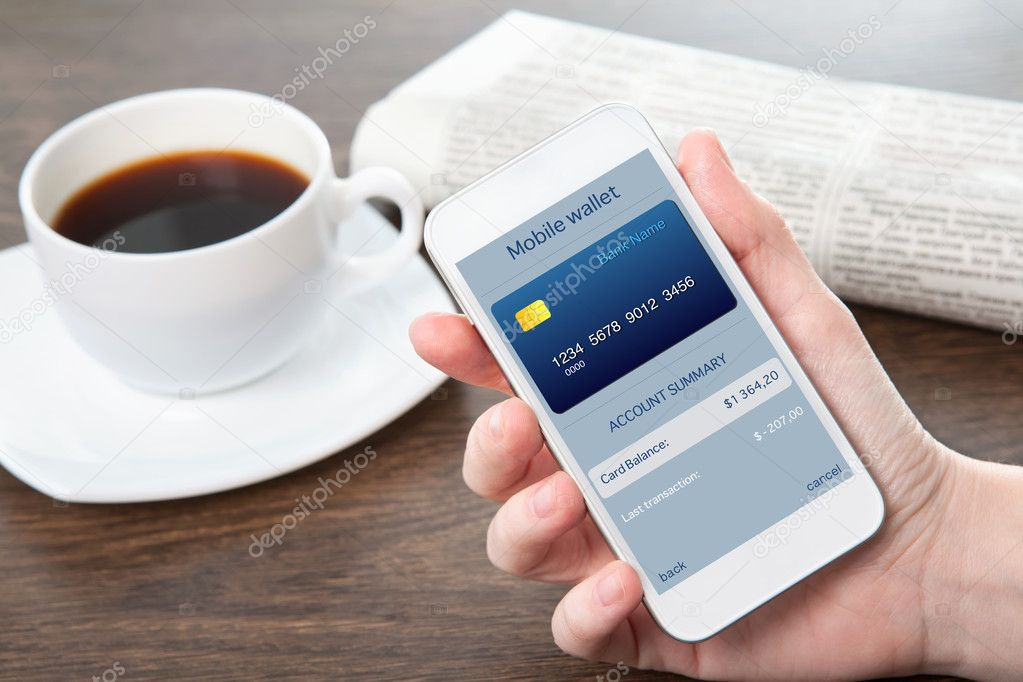 businesswoman hand holding a phone with mobile wallet onlain sho
