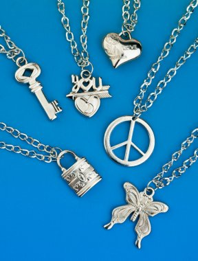 collection of silver pendants