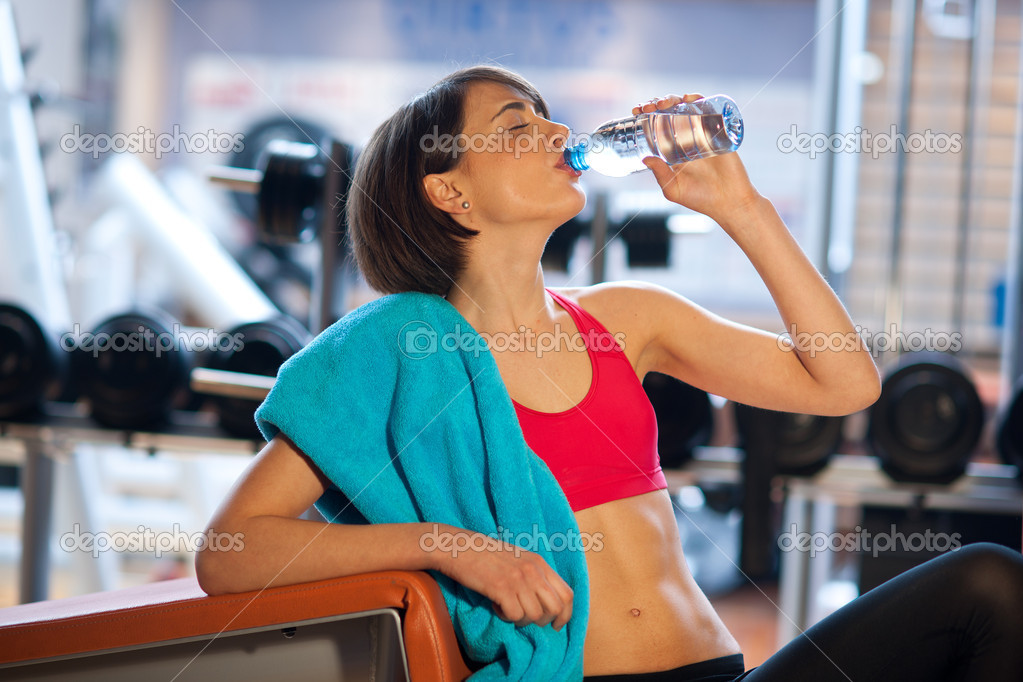 Woman in gym drink water stock photo bertys30 19724181 woman in gym drink water stock photo 19724181 sciox Choice Image