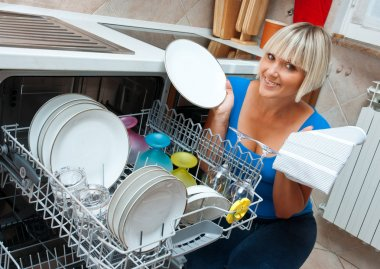 attractive woman washing dishes