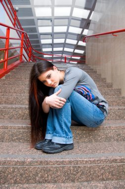 sad teen girl on school stairs