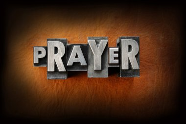 The word prayer made from vintage lead letterpress type on a leather background. stock vector