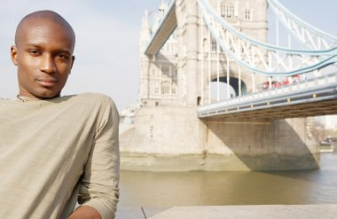 Attractive african american man standing by Tower Bridge in London