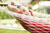 young man relaxing on a hammock