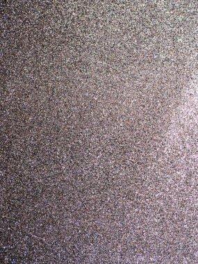 Full frame silver glitter background texture.