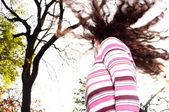 Fotografie Junge Mädchen stand in einem Herbst-park