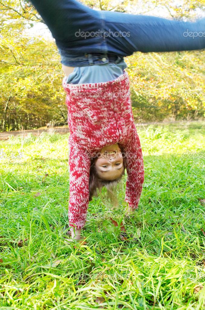 Young teenager girl doing cartwheels