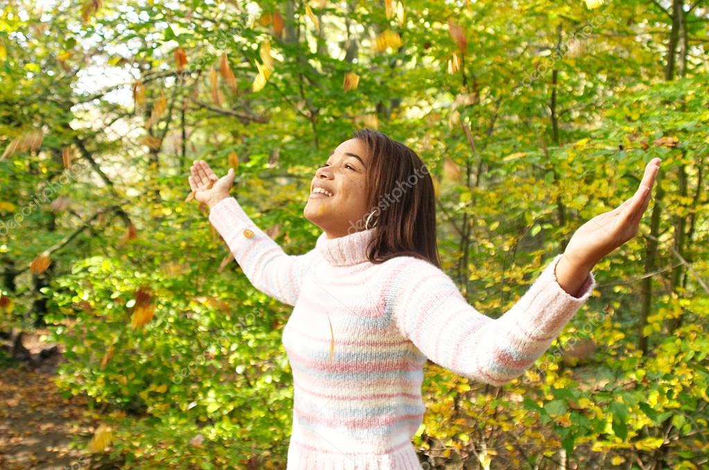 Young teenager walking through an autumn park