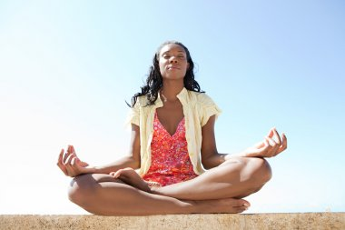 African woman meditating