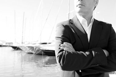 Businessman standing by a luxury yachts