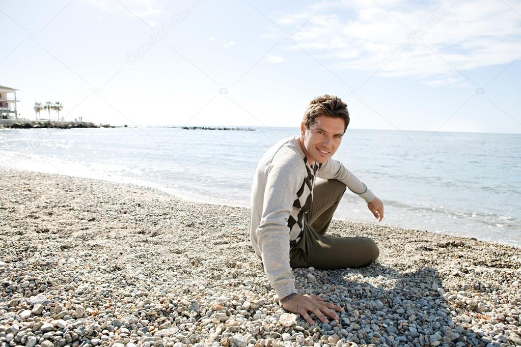 Man sitting down on the shore