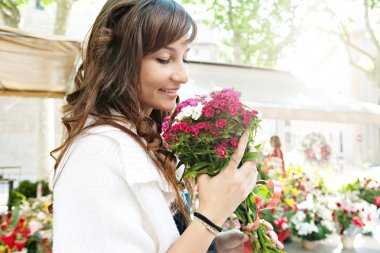 Woman smelling f flowers