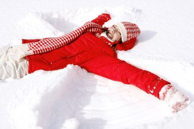 Woman laying down on the snow