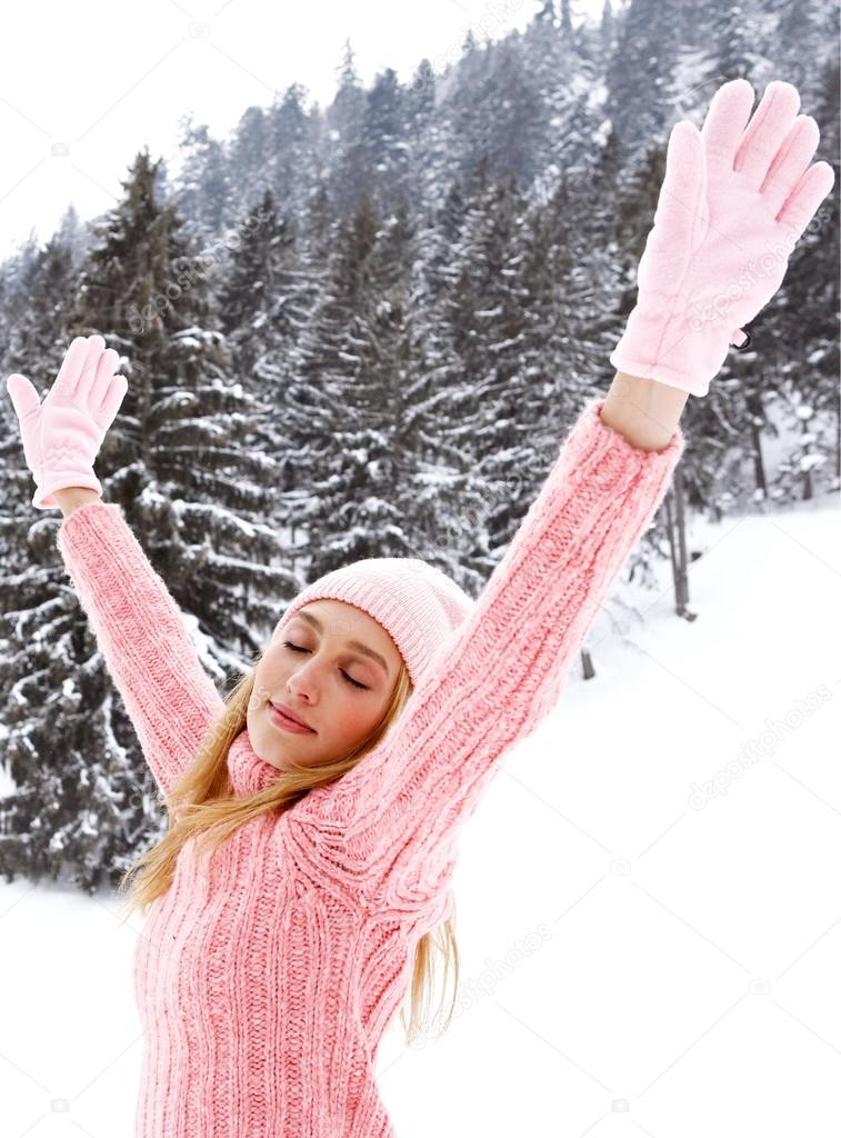 Woman in  snowed mountains