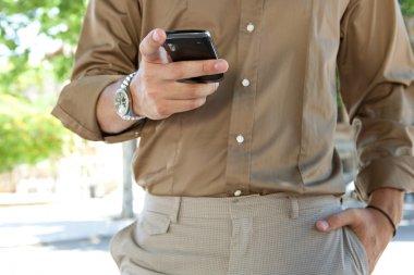 Businessman using his smart phone