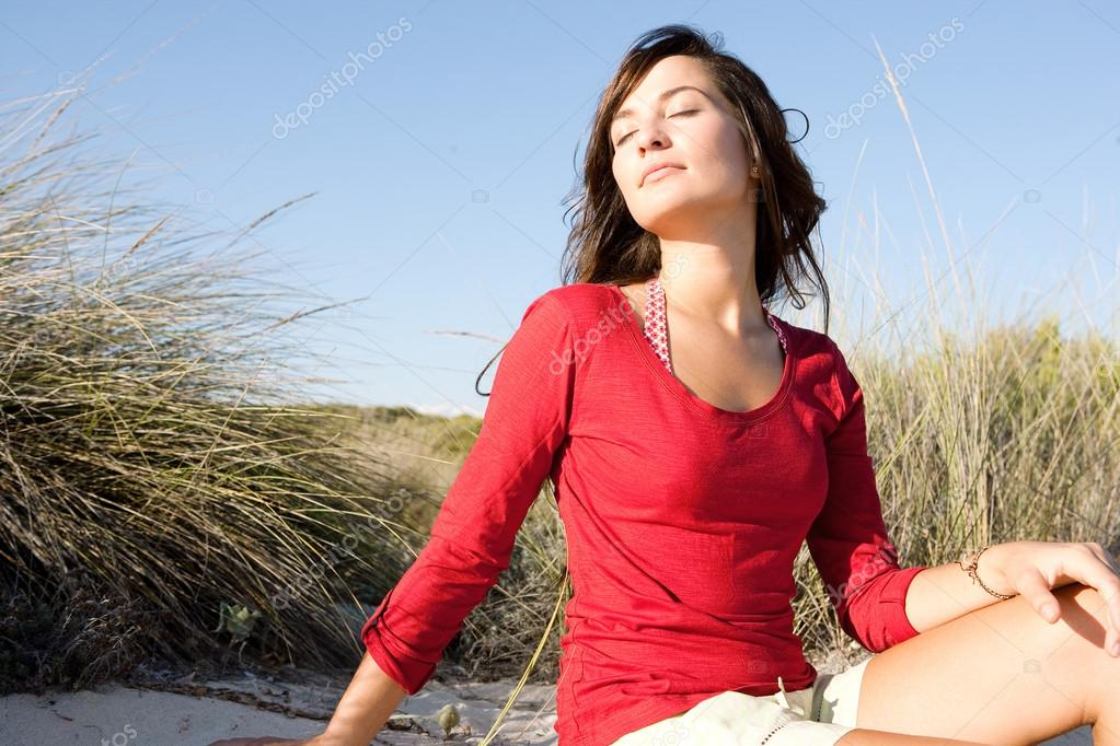 Woman   sitting on a beach