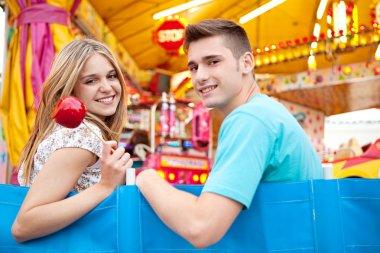 Couple visiting a funfair