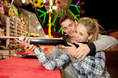Ouple playing shooting games