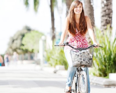 Woman riding a bycicle