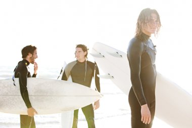 Surfers standing on a beach