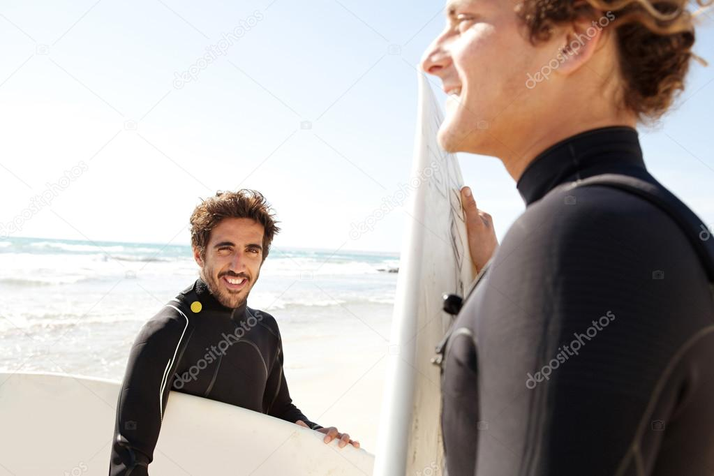 Young surfers  on beach