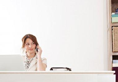 Businesswoman sitting in office