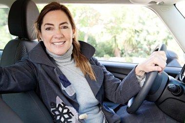 Woman sitting on car,
