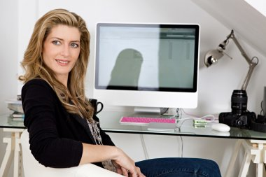 Professional woman sitting on her work desk