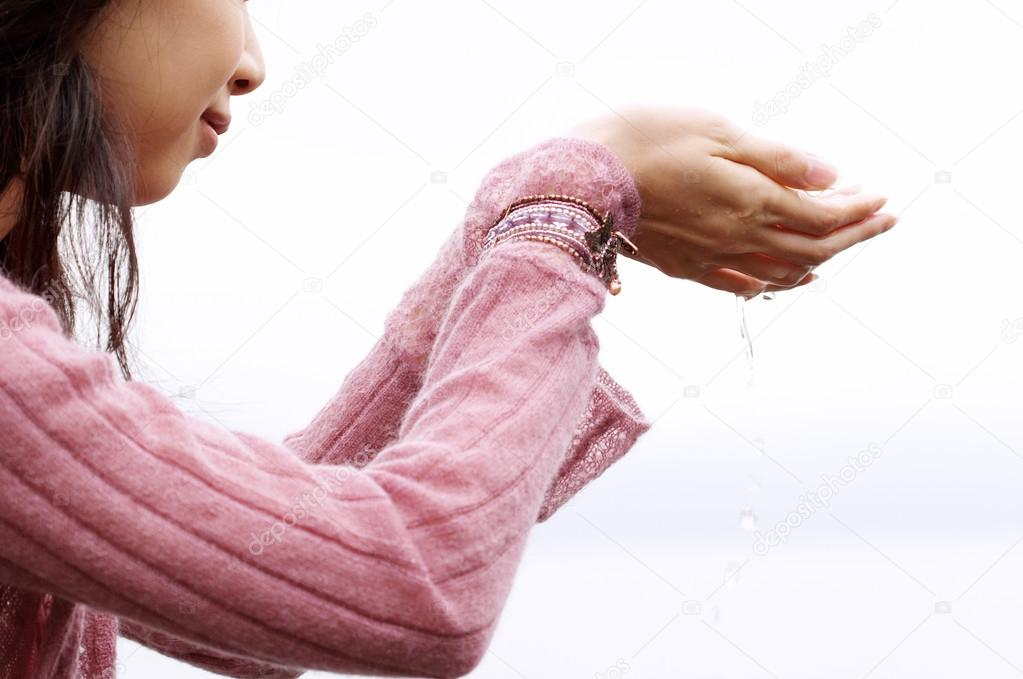 Woman holding her hands together