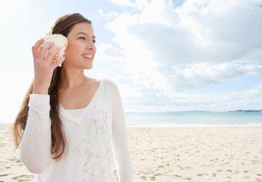 Woman holding a sea shell