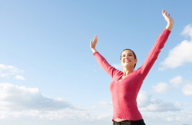 Woman standing with her arms outstretched
