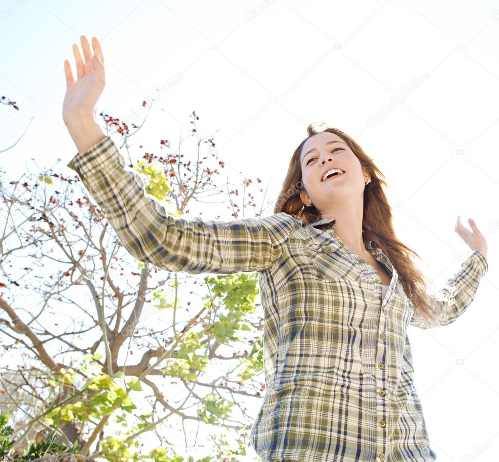Woman being playful with her arms outstretched