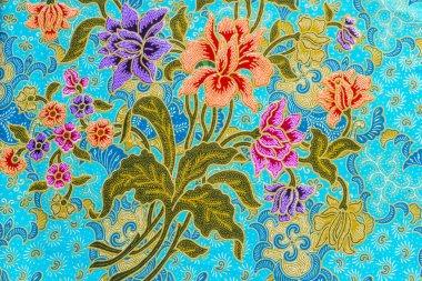 Beautiful colorful flowers on batik background