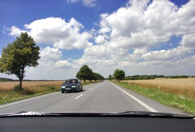 View of a summer czech road from a vehicle interior