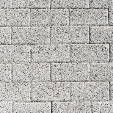 Grey rectangle pavement tiles. Texture background.